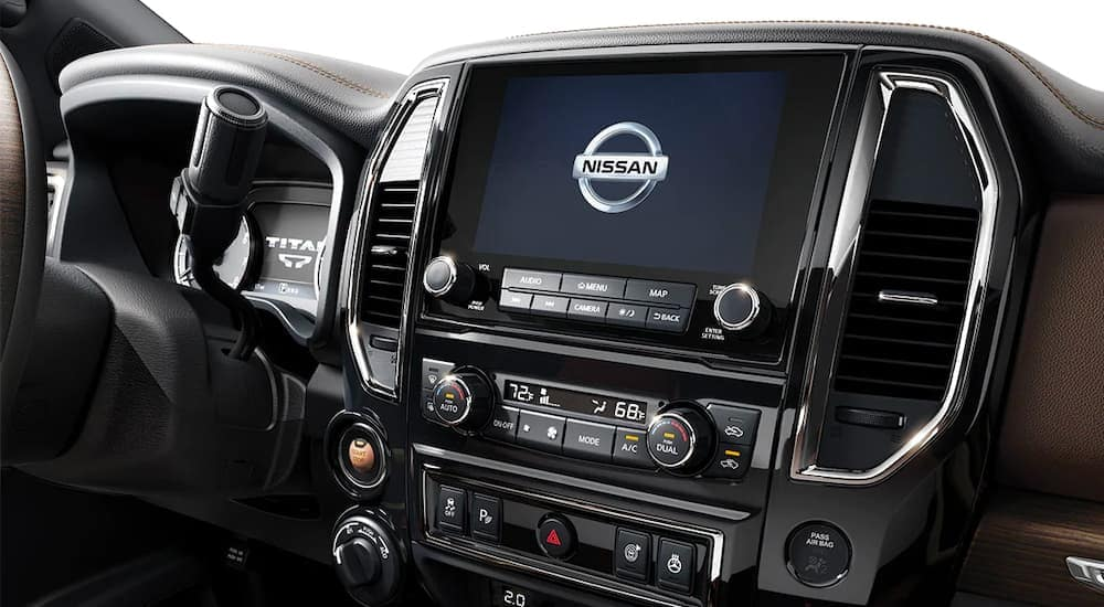 A close up is shown of the infotainment system on a 2021 Nissan Titan XD.