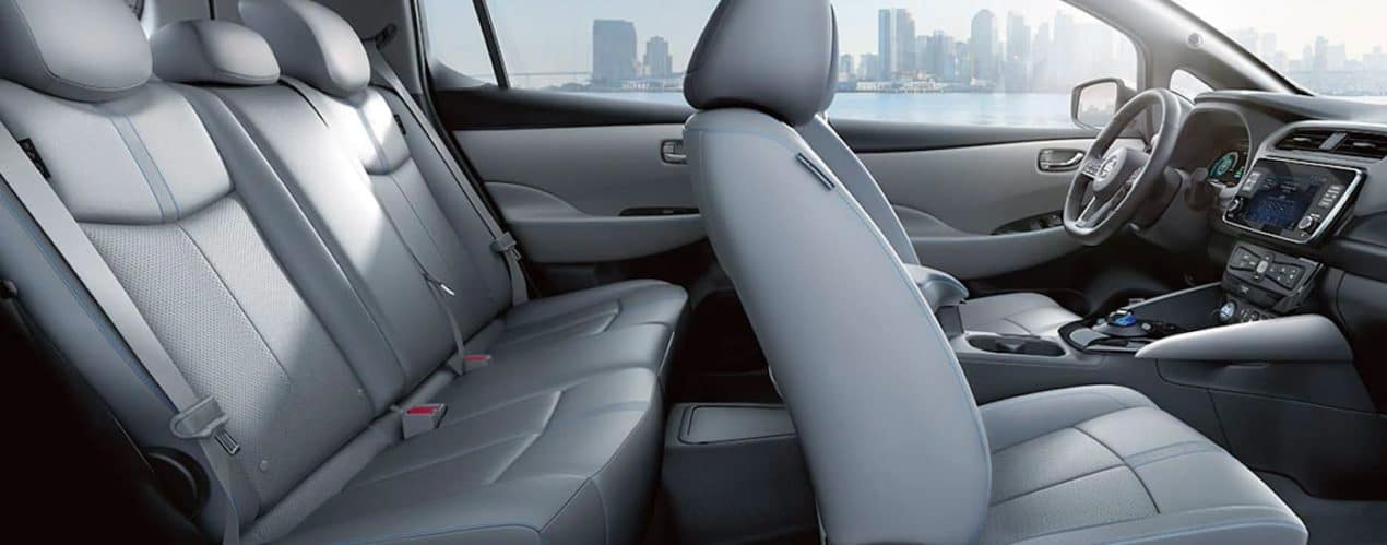 The grey interior is shown from the passenger side on a 2021 Nissan LEAF.