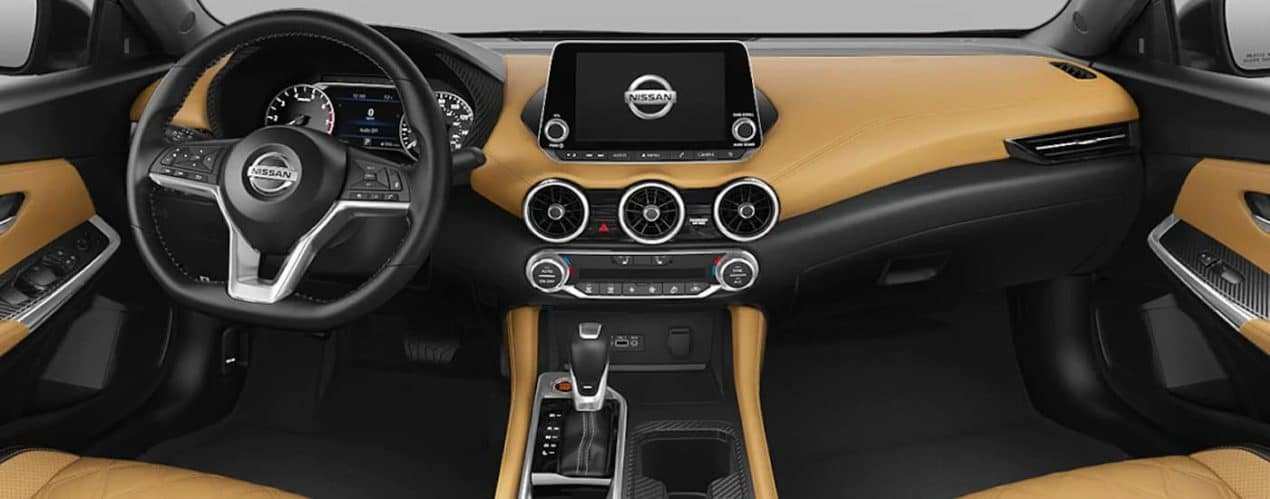 The tan and black front seats and dashboard on a 2021 Nissan Sentra are shown.