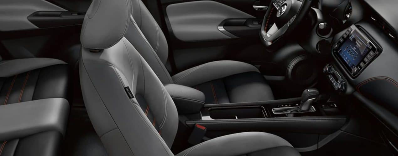 The black and grey interior of a 2021 Nissan Kicks is shown.