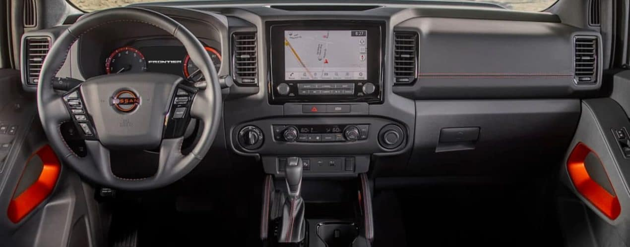 The wheel and screen in a 2022 Nissan Frontier are shown.