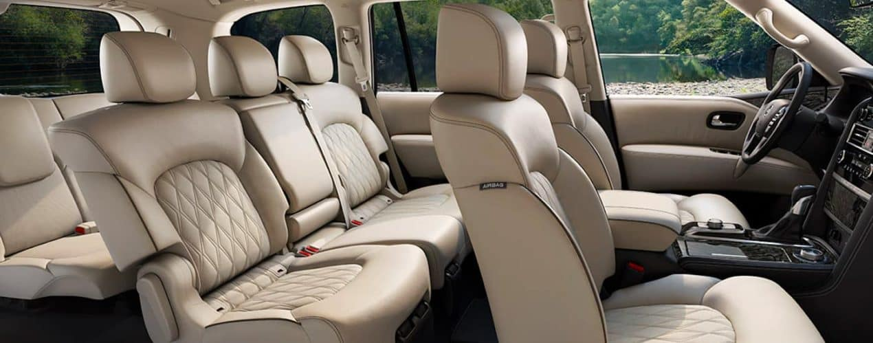 The tan interior and three rows of seating are shown in a 2021 Nissan Armada.