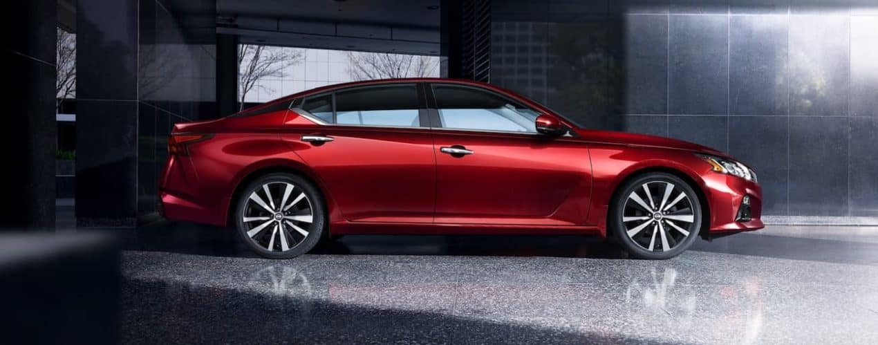 A red 2021 Nissan Altima is shown from the side.