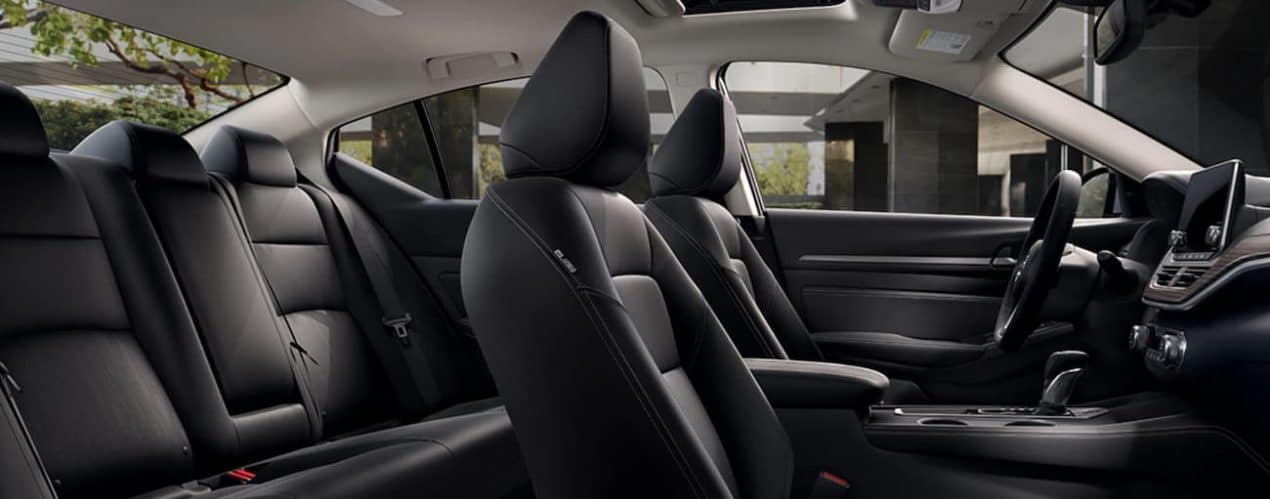 The black interior of a 2021 Nissan Altima is shown during a 2021 Nissan Altima vs 2021 Toyota Camry comparison.