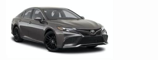 A silver 2021 Toyota Camry is angled right.