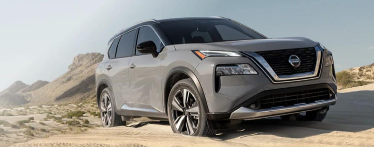 A grey 2021 Nissan Rogue is off-roading in desert sand after winning the 2021 Nissan Rogue vs 2021 Chevy Equinox comparison.