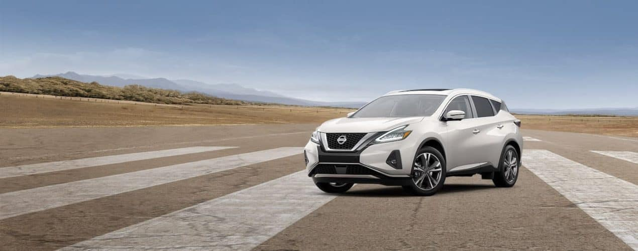 A white 2021 Nissan Murano is shown parked on pavement.