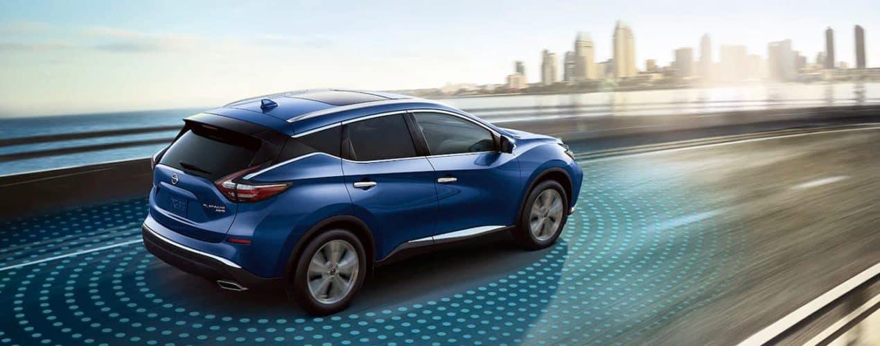 A blue 2021 Nissan Murano Platinum is shown driving toward a city after winning a 2021 Nissan Murano vs 2021 Chevy Blazer.