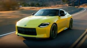 A yellow 2021 Nissan Z is angled left.