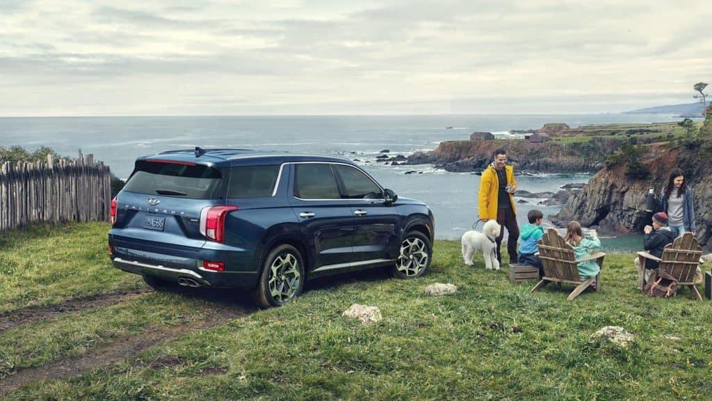 Family at coast with Hyundai Palisade