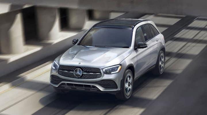 Silver Mercedes-Benz SUV driving on a bridge