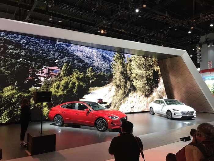 red and white hyundai models at 2020 Auto Show