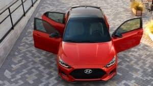2021 Hyundai Veloster in red with doors open.