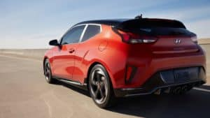 2021 Hyundai Veloster in red side shot.