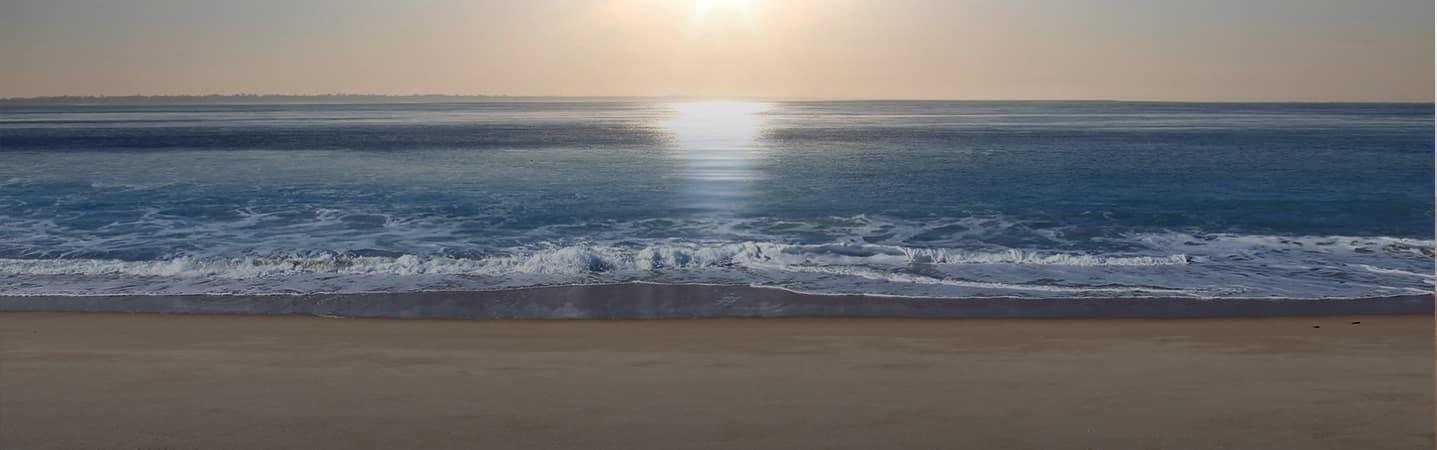 Ocean and Beach with Sun Setting