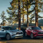 Toyota Highlander models parked near cabin