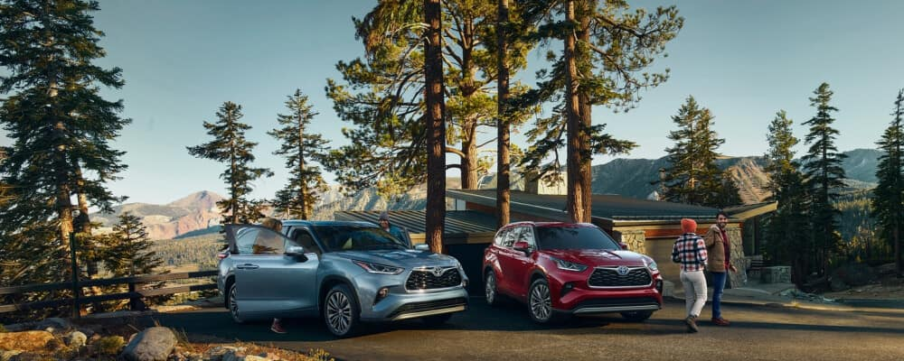 Toyota Highlander models parked near cabin