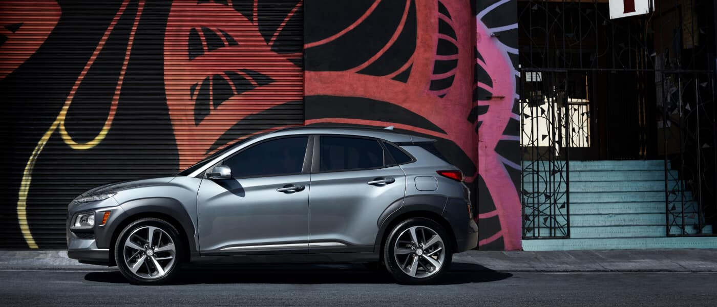 A 2020 Hyundai Kona Parked in front of a mural