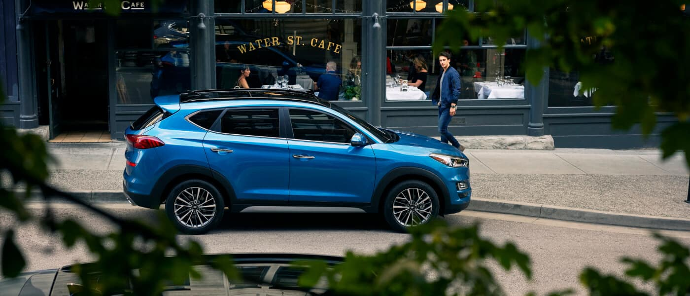 A blue Hyundai Tucson parked on the street